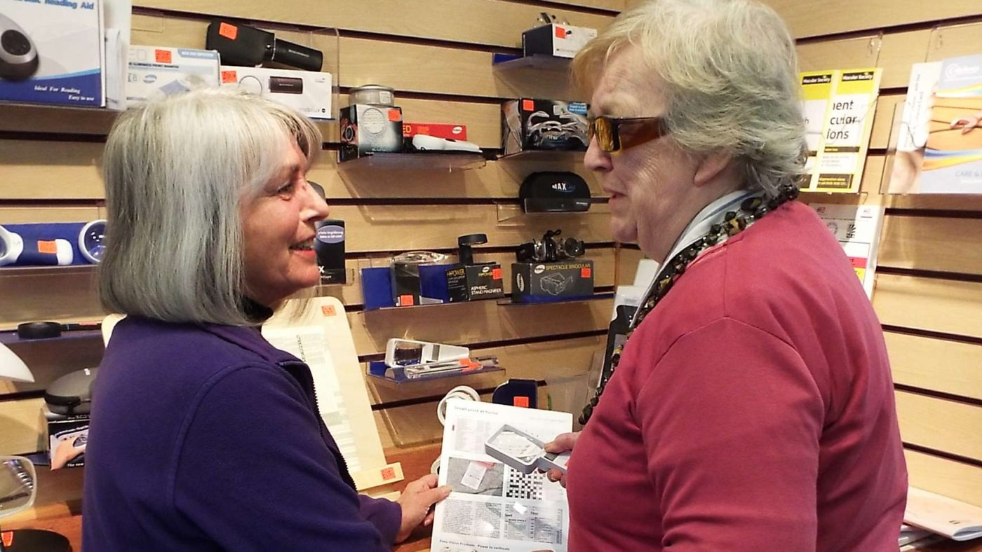 VisionPK Worker explaining aids to client